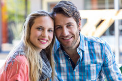 Smiling couple having tea in a cafe Stock Photo