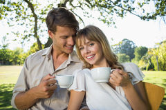 Smiling couple having tea outside in a cafe Royalty Free Stock Images