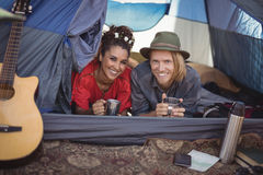 Smiling couple having tea in tent Royalty Free Stock Images