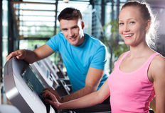 Smiling couple in health club Stock Photography
