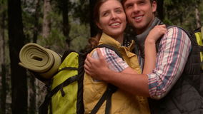 Smiling couple on a hike in the countryside stock video