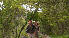 Smiling couple on a hike in the countryside stock footage