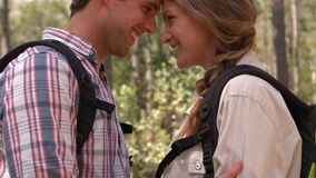 Smiling couple on a hike hugging stock footage