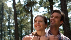 Smiling couple on a hike hugging stock video footage