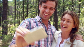 Smiling couple on a hike taking a selfie stock video