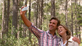 Smiling couple on a hike taking a selfie stock video footage