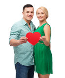 Smiling couple holding big red heart Stock Photos