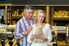 Smiling couple holding bread in paper bag Stock Photography