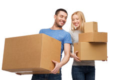 Smiling couple holding cardboard boxes Stock Images