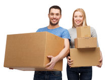 Smiling couple holding cardboard boxes Stock Photo