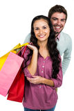 Smiling couple holding colorful shopping bags Royalty Free Stock Images