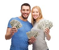 Smiling couple holding dollar cash money Stock Photos