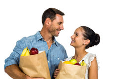 Smiling couple holding grocery bags Stock Photo