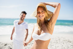 Smiling couple holding hands. On the beach royalty free stock photos