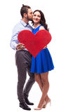 Smiling Couple  holding heart and kiss Royalty Free Stock Image