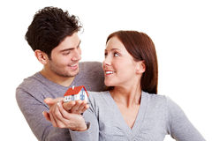 Smiling couple holding a house Stock Photo