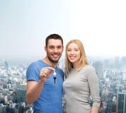 Smiling couple holding keys Stock Photography