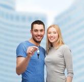Smiling couple holding keys Stock Image