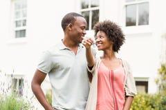 Smiling couple holding keys Stock Images