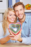 Smiling couple holding many hearts Royalty Free Stock Photo
