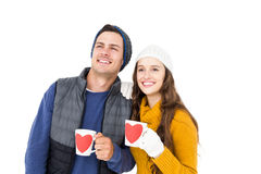 Smiling couple holding mug and looking away Royalty Free Stock Photos