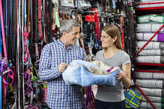 Smiling Couple Holding Pet Bed At Store Royalty Free Stock Photo