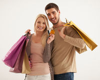 Smiling Couple Holding Shopping Bags Royalty Free Stock Photos
