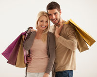 Smiling Couple Holding Shopping Bags Stock Images