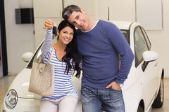 Smiling couple holding their new car key Royalty Free Stock Image