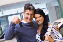 Smiling couple holding their new car key Stock Image