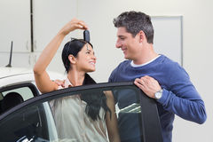 Smiling couple holding their new car key Stock Photos