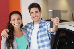 Smiling couple holding their new car key Stock Images
