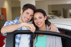 Smiling couple holding their new car key Stock Photography