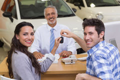 Smiling couple holding their new car key Stock Photo