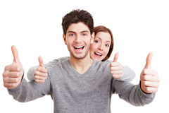 Smiling couple holding thumbs up Stock Photography