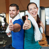 Smiling couple holding thumbs up Royalty Free Stock Image