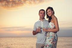 Smiling couple holding wineglasses Stock Image