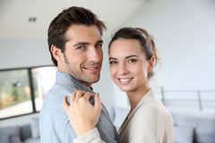 Smiling couple at home stock photography