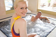 Smiling couple in hot tub Stock Image