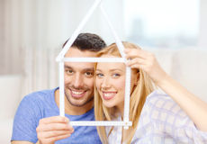 Smiling couple with house from measuring tape Stock Image