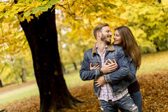 Smiling couple hugging in autumn park and having fun Stock Image
