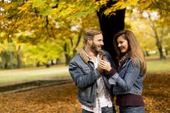 Smiling couple hugging in autumn park and having fun Royalty Free Stock Image