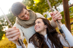 Smiling couple hugging in autumn park Stock Photography