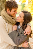 Smiling couple hugging in autumn park Royalty Free Stock Photos