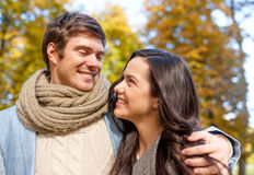 Smiling couple hugging in autumn park Royalty Free Stock Image