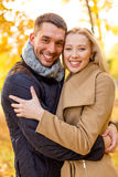 Smiling couple hugging in autumn park Royalty Free Stock Images