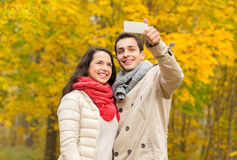 Smiling couple hugging in autumn park Royalty Free Stock Photo