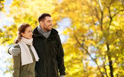 Smiling couple hugging in autumn park stock image