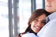 Smiling couple hugging each other Stock Image