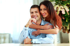 Smiling couple hugging at home Royalty Free Stock Photo